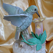 Music box figure hummingbird on trumpet flower pastel colors