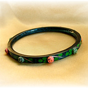 Vintage celluloid bangle in dark blue with applied rose buds
