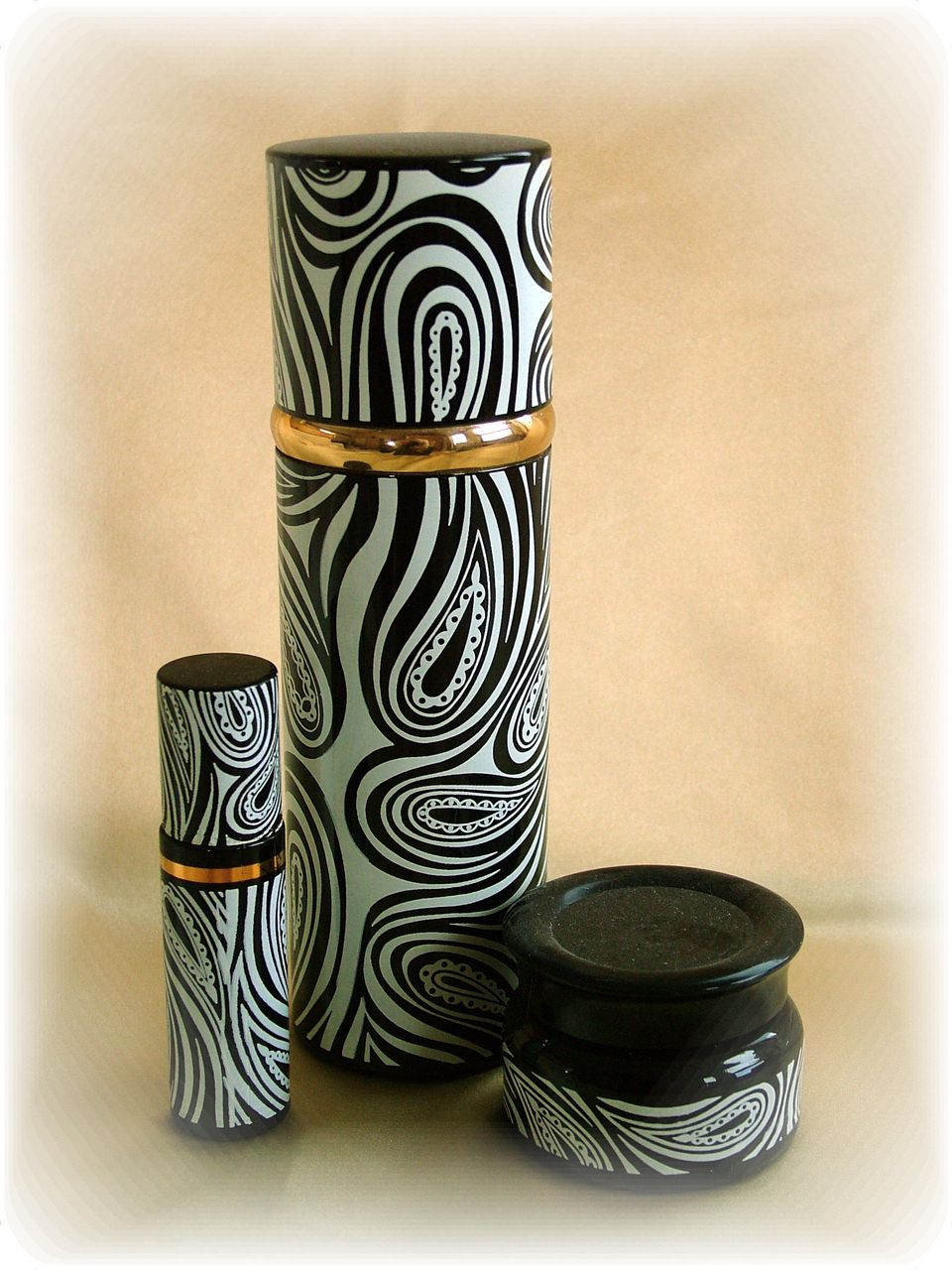 Set of vintage black and white paisley cologne bottles