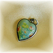Rare vintage celluloid and sterling silver puffy heart charm