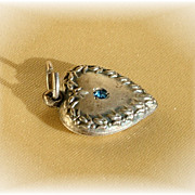 Vintage puffy sterling silver heart charm with blue stone