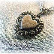Vintage sterling silver double sided puffy heart charm with paisley border