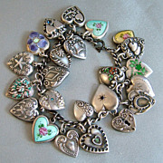 SOLD Fabulous collection of  23 vintage puffy heart charms bracelet enamels pansy