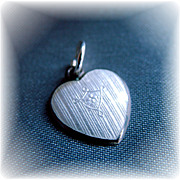 White guilloche enamel heart charm on sterling vintage