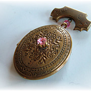 Pididdly Links locket pin with pink rhinestone