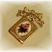 Book style locket on pin with enamel roses