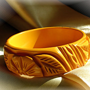 Vintage wide carved mustard bakelite bangle bracelet