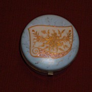 Milk Glass Dresser Box with Enameled Floral Decoration on blue background