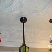 Matching pair of early single stem light fixtures with matching slag glass shades