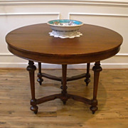 Antique American Walnut Round Extending Dining Table.