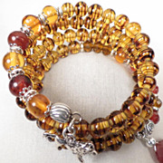 England My Lionheart Coil Bracelet Amber Carnelian Czech Tortoiseshell Glass Lion Charm