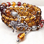 England My Lionheart Coil Bracelet 2 Amber Carnelian Czech Tortoiseshell Glass Lion Charm