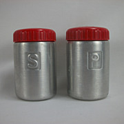 SOLD Bakelite Red Top Aluminum Salt and Pepper Shakers Mid Century