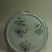 German porcelain trivet with a lavender poppy pattern