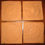 Four Bisque Ceramic Tiles from Butter Molds