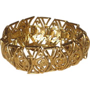 Vintage Monet Wide Gold Tone Openwork Bracelet