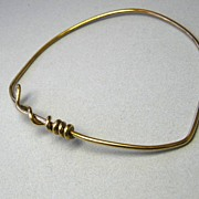 Modern bronze bangle with a twist minimalist cuff bracelet
