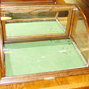 Small Oak curved glass countertop gum display case