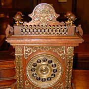 Unusual Ansonia oak mantel clock with brass trim