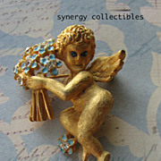 Florenza Cupid Brooch With Enameled Bouquet of Flowers
