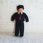 REDUCED Celluloid Boy European Doll with black felt suite and hat, Jointed Hand Painted