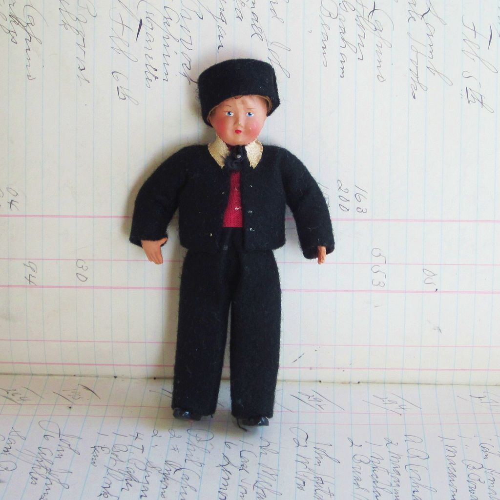 Celluloid Boy European Doll with black felt suite and hat, Jointed Hand Painted