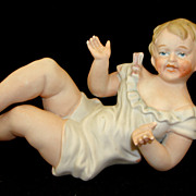 Antique German Porcelain Bisque Piano Baby Figurine