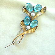 Symmetalic sterling & 14k blue topaz rhinestone and faux pearl brooch