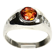 Dramatic Platinum Ring set With a Rare Orange Sapphire & Diamonds
