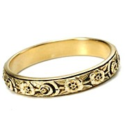Flowery Design on a Simple Band of Gold