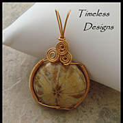 SOLD Wire Wrapped Bronze Sand Dollar Fossil Pendant