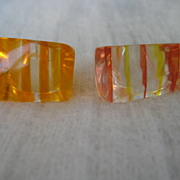 Two Vintage Striped Orange Lucite Rings