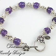 ALISSA � Striking amethyst bracelet heavy with Balinese sterling silver