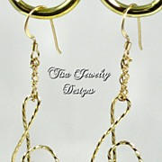 TREBLE CLEF EARRINGS � of hand-wrapped & twisted 14 Kt gold-filled wire