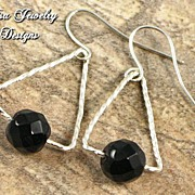 ILLUSION � Faceted black onyx earrings on handcrafted tarnish-resistant silver frames and ear