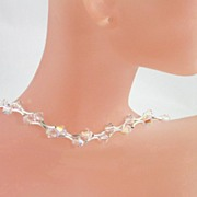 SAVANNAH NECKLACE � Stunning sparkler with double-curved sterling silver tubes and Swarovski c