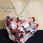 HEART GEMS II � Hand-wrapped Argentium silver heart bursting with garnet and rose quartz gemst