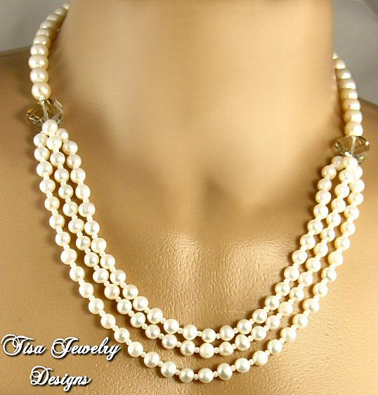 JASMINE &ndash; Creamy freshwater cultured pearls and Swarovski Cosmic Crystals. 14 Kt Gold Clasp