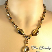 TAYLOR � Necklace and earrings of beautiful smoky quartz smooth nuggets.