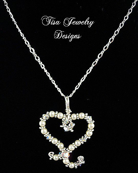 SWIRLED HEART PENDANT &ndash; Swarovski Crystals and crystal pearls hand-formed into a swirled heart design