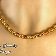 AMBER � Set of genuine amber necklace and earrings. 14 KT gold clasp.