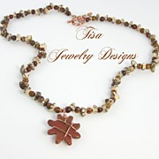 DANCE � Unisex necklace of Tagua nuts, fancy jasper and copper-bound star pendant