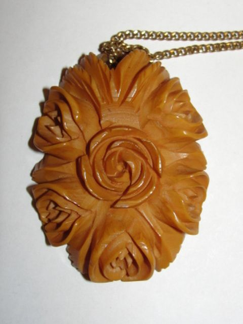 14 kt Gold Filled and Carved Bakelite Butterscotch Floral Pendant Necklace