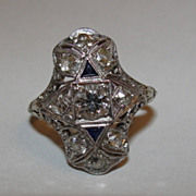 Art Deco Platinum and 18 kt Gold Diamond Filigree and Blue Sapphire Millgrain Ring