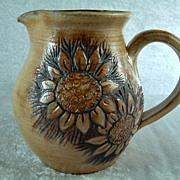 Vintage Artisan Pottery Pitcher with Sunflower Design