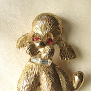 PELL Sitting Poodle Dog Pin with Red Rhinestone Eyes