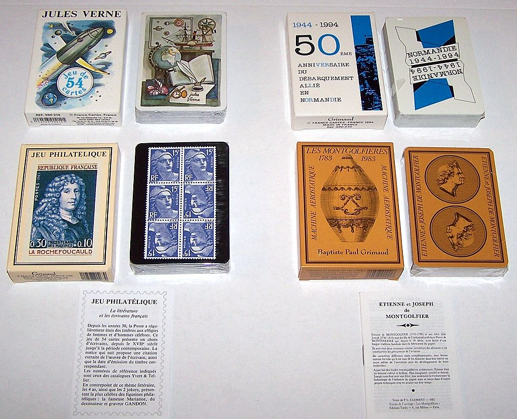 "4 Decks Grimaud Playing Cards, $15/ea.: (i) ""Jules Verne,"" Jean Bruneau Designs, c.1978; (ii) ""Normandie 1944-1994,"" Yannick Pennanguer Designs, c.1993; (iii) ""Jeu Philatelique,"" Jacques Hiver Designs, c.1990; (iv) ""Les Montgolfieres,"" c.1983"