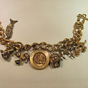 SALE Monet Gold Tone Charm Bracelet