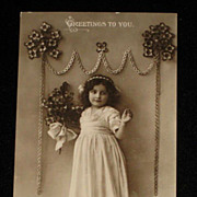 Glossy Antique Real Photo Postcard of Young Girl with Bouquet-Greetings to You