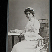 Antique Small German Cabinet Card of Beautifully Dressed Young Woman in Ornate Chair Reading a